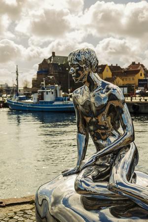 HELSINGOR, DENMARK; MARCH 24, 2019. Statue called HAN in the harbor, created by artist team Elmgreen Dragset.