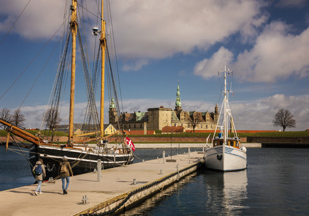 View of Kronborg castle and sail boats in the harbour of Helsingor, Denmark.