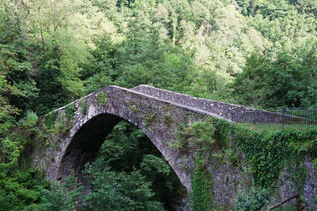 niches: Ancient Medieval bridge in Tuscany, Italy  Stock Photo