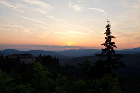 Sunset on the hills of Tuscany, with several layers of hills