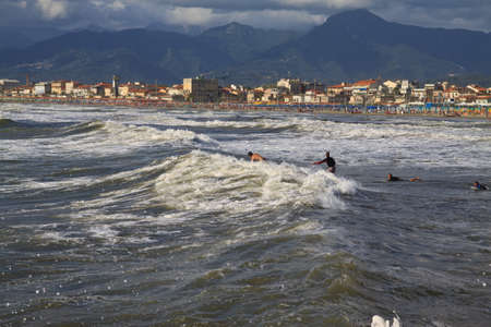 An image of people practicing surf in the beach