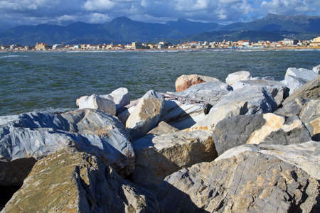 Group of rocks used as a defence against the sea in the port of viareggio  Stock Photo