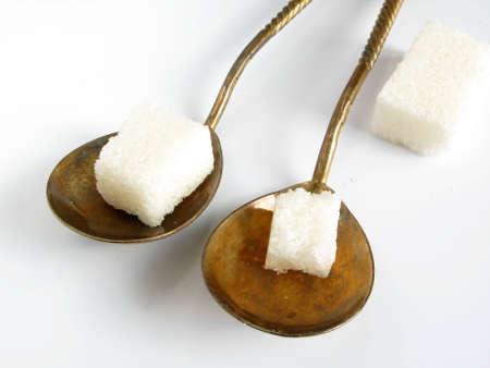 heap snow: spoon sugar Stock Photo