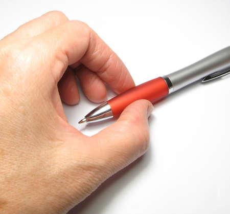 Women's arm with a ballpoint pen. Stock Photo - 5110586