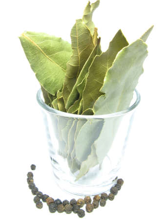 smack: black pepper and bay leaf in a glass