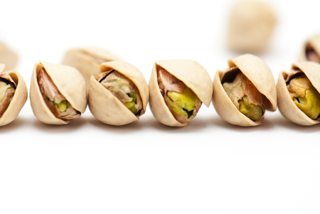 pistachios heap on white background