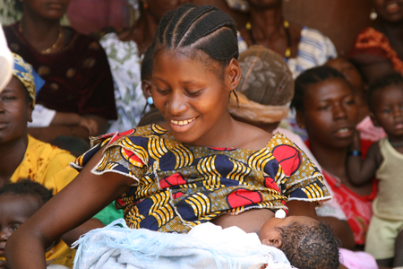 african woman breastfeeding her baby