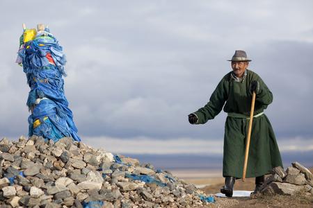 Mongolian shepherd offering at a sacrificial site