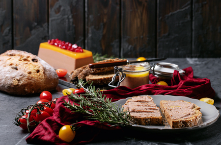 Home made liver pate served on sourdough bread with pomegranate seeds, rosemary and cherry tomatoes