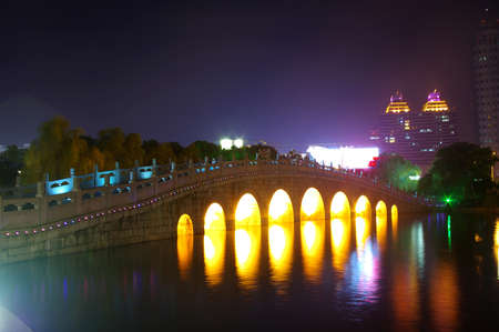 Arch bridge at night photo