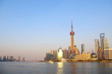 In the 2012 Shanghai city skyline at dusk