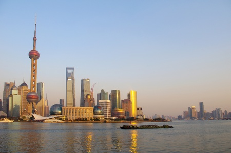 In the 2012 Shanghai city skyline at dusk