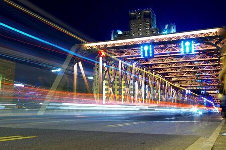 Shanghai Bridge traffic at dusk photo