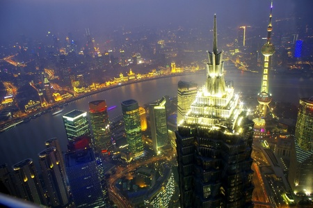 overlooking shanghai at night from shanghai world financial center 2012