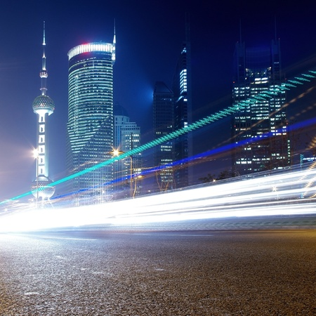 Night in Shanghai, China, construction and traffic light trails