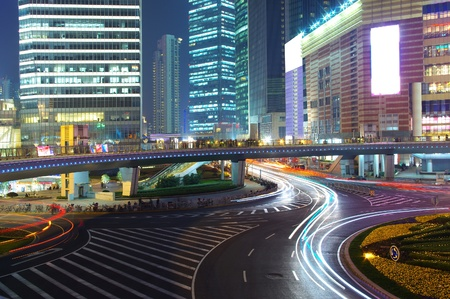 Night in Shanghai, China, construction and traffic light trails photo