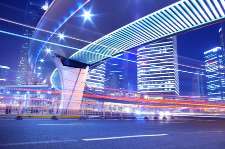 Night in Shanghai, China, construction and traffic light trails Stock Photo - 13370341