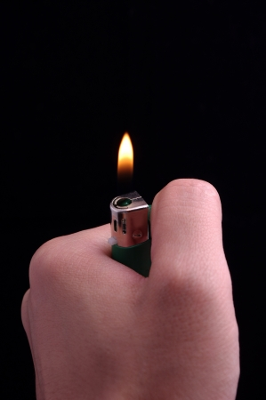 Hand and a lighter photo