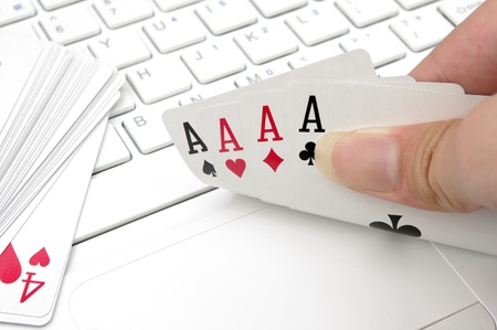 Poker and the computer keyboard  the expression of an online poker game or against the concept of online gambling  photo