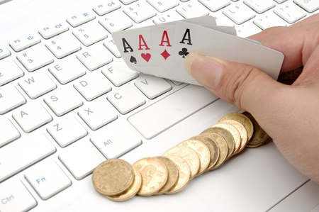 Poker, money and computer keyboard  the expression of an online poker game, or against the concept of online gambling  photo