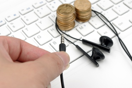Keyboard headset and money  to express the concept of a paid download and listen to music  photo