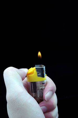 Hand and a lighter Stock Photo - 14516589