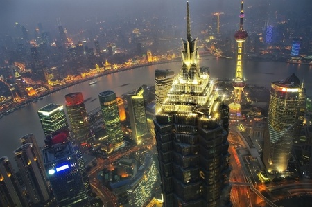 Panorama of the city the night in Shanghai, China photo
