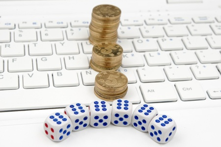 Keyboard and dices  to express the concept of banning Internet gambling  photo