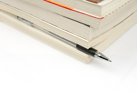 Pens and books  to express the concept of reading Stock Photo - 14453996