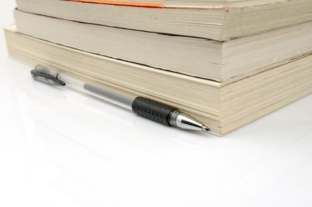 Book stack pen Stock Photo - 16803137