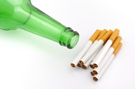 Beer bottles and cigarette photo