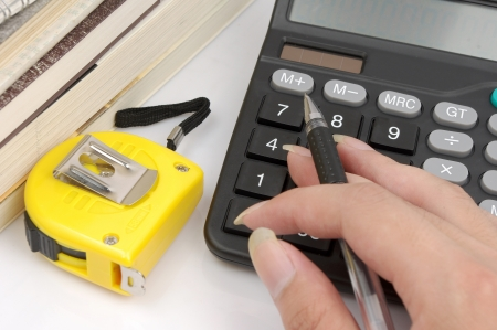 Ruler and calculator  Housing construction or renovation prices concept  Stock Photo