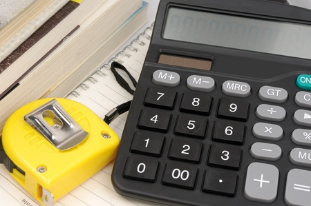 housing prices: Ruler and calculator  Housing construction or renovation prices concept  Stock Photo