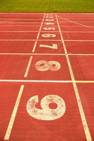 red plastic runway and numbers in a sports ground photo