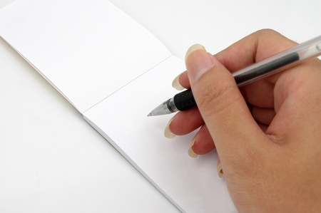 Hand and notebook Stock Photo - 17738521