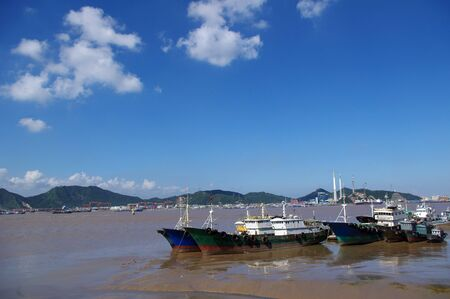 Blue sky fishing boat photo