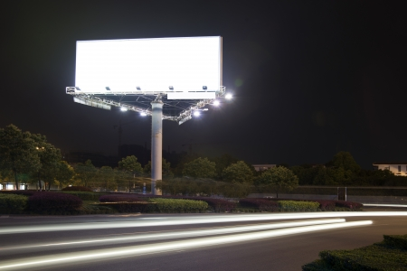 Billboard at night light trails photo