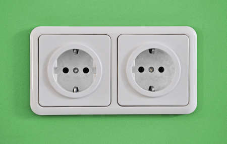Electric Outlet On Green Wall photo