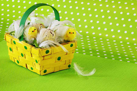Basket with eggs and chickens - Easter decoration Standard-Bild