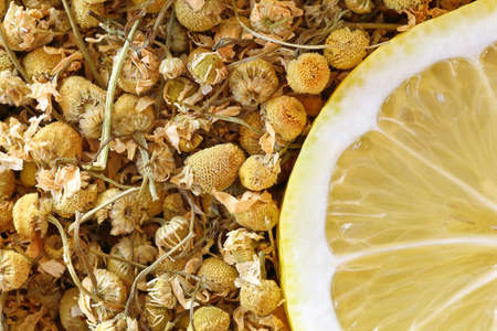dried chamomile flowers and lemon slice