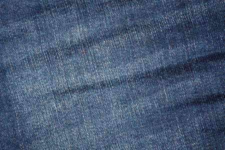 Wrinkled and discolored jeans fabric - background