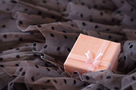 Romantic background with surprise in a pink box Standard-Bild