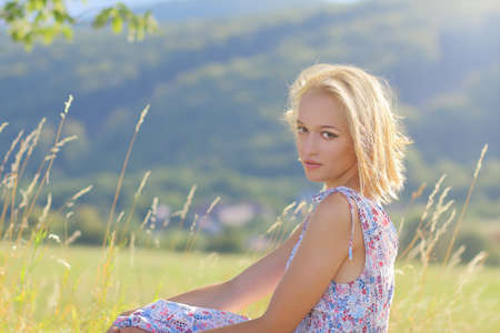 Young attractive woman in nature Standard-Bild