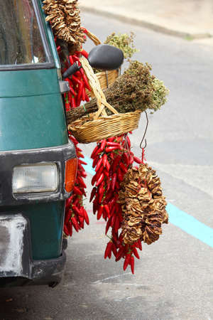 Car with herbs and spices on a street in Calabria