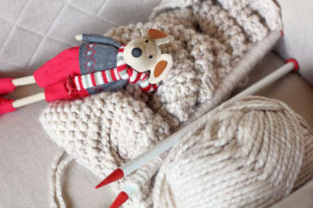 Home sweet home, handmade knitwear and toy on the stool Standard-Bild