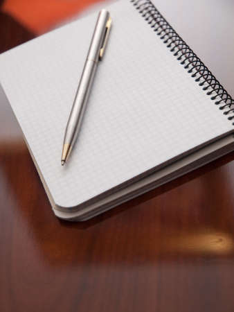 A pen on a notebook ready to take notes photo