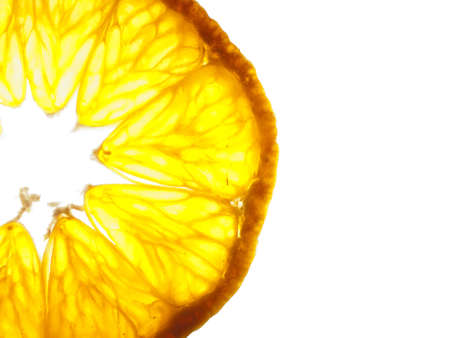 Closeup of a sliced up tangerine backlit Stock Photo - 6307072