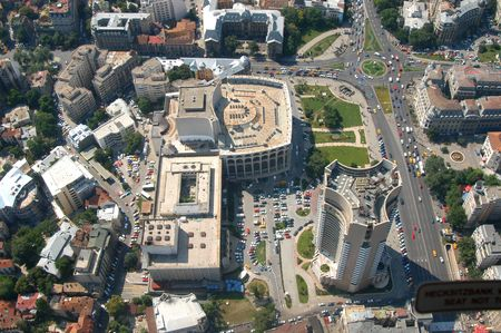 Downtown Bucharest, capital of Romania - University square, an important place in 1989 anti-communism revolution, National Theatre (middle) and biggest hotel in town (right, under) - picture taken from a zeppelin