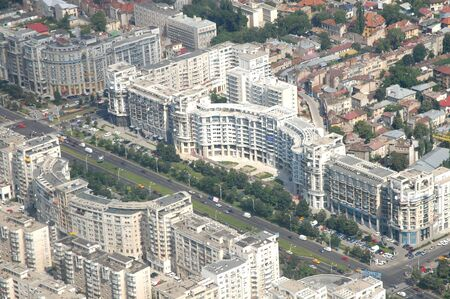 communist: Bucharest cityscape, buildings near Parliament House, built by communist dictator Ceausescu - pictutre taken from a zeppelin Stock Photo