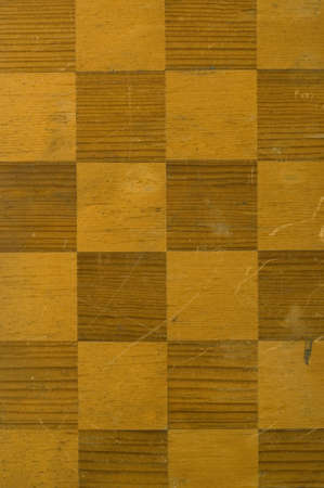 detail of an old worn wooden checkerboard photo